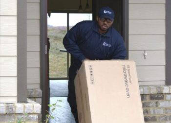 Last Mile Delivery man delivering to a home